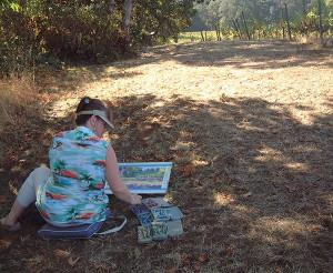 Painting plein air in a vineyard.