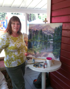 Susan painting on the porch of Red House Art in Graeagle, CA.