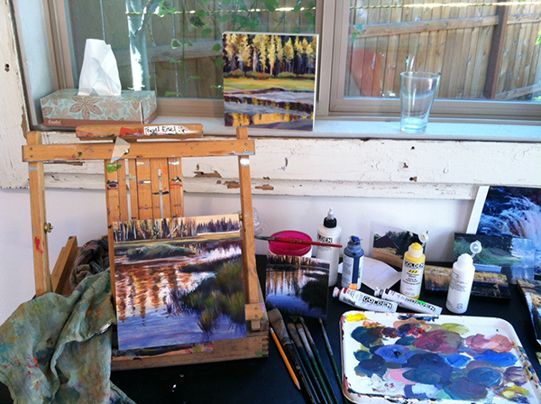 Painting in the studio at Clearwater Gallery in Sisters